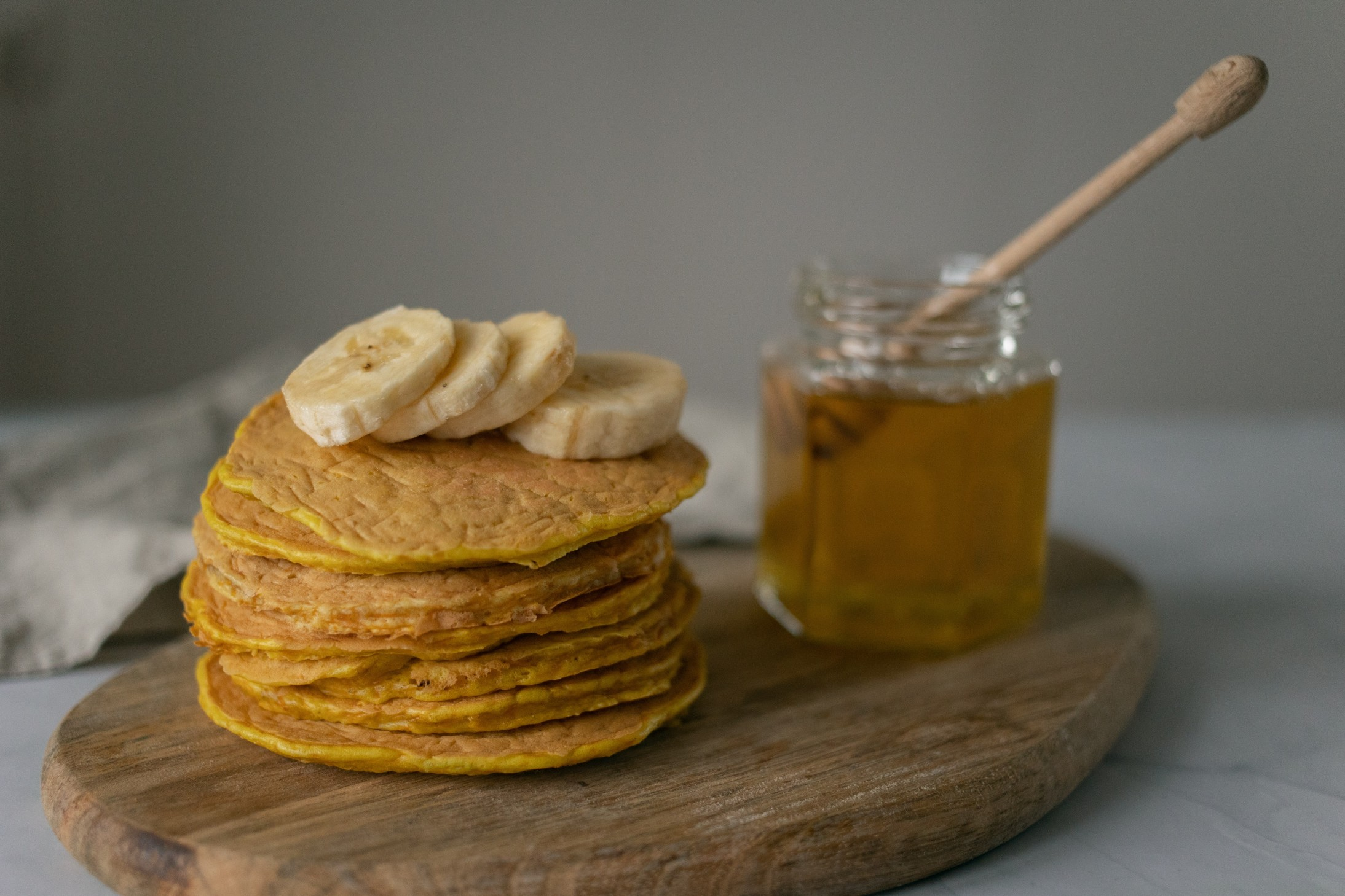 pancakes with banana on top and honey